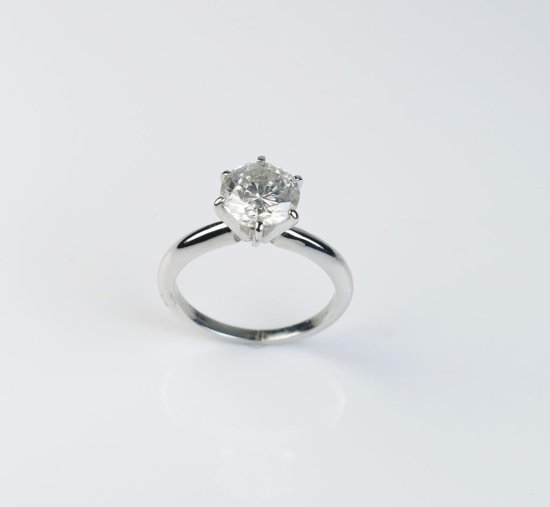 Brilliant 14 karat white gold solitaire featuring a round Diamond