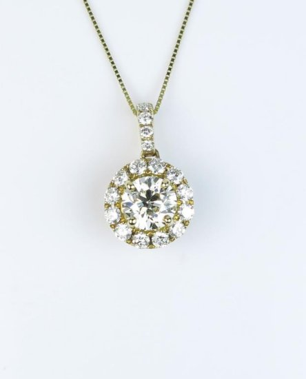 Stunning pendant featuring an extra fine European cut diamond weighing