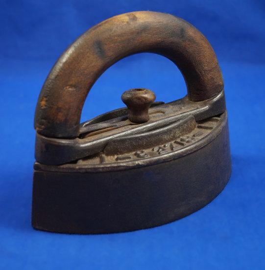 """Sad iron detachable wooden handle, No. 50, size 3, Ht 5 1/4"""", 6 3/4"""" long"""