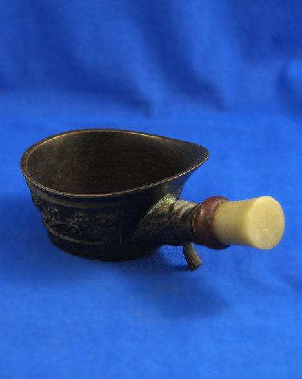 """Oriental pan iron, flower design, Ht 2"""", 5 1/2"""" long"""