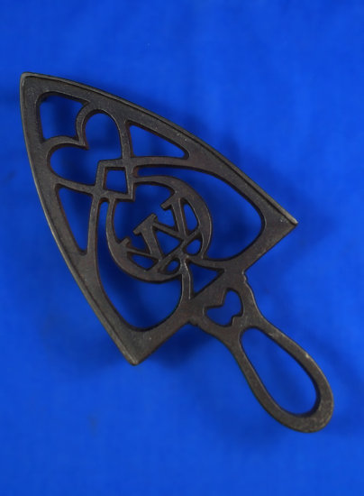 "Trivet, circled W, 9"" long"