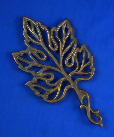 "Leaf shaped trivet, made in Israel, brass, 8 1/2"" long"