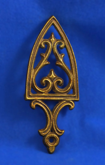 "Brass trivet, 5 3/8"" long"