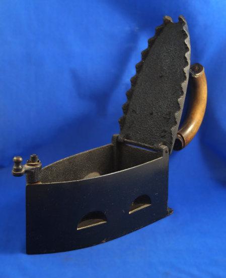 "Charcoal iron, wood handle, Ht 9 1/2"", 9 1/4"" long"
