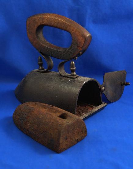 """Ox tongue box iron with slug, rear flip door, wood handle, Ht 6"""", 8"""" long"""