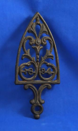 """Trivet, """"1894"""", 8 3/4"""" long"""