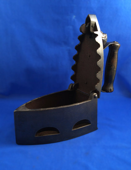 """Charcoal iron, cast iron, wood handle, ornate lid, woman's head top latch, Ht 7 1/4"""", 7 1/4"""" long"""