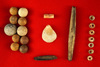Group of assorted  Shell and bone beads, shell pendant and 10 clay and stone marbles - Alabama.
