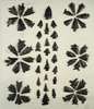 Nice selection of obsidian arrowheads found in Fort Rock, Oregon which are glued to a board.