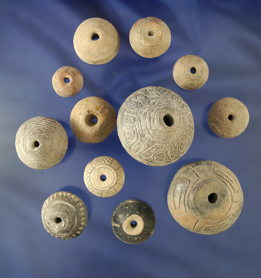 Group of 12 Pre-Columbian pottery beads and spindle whorls found in Mexico.