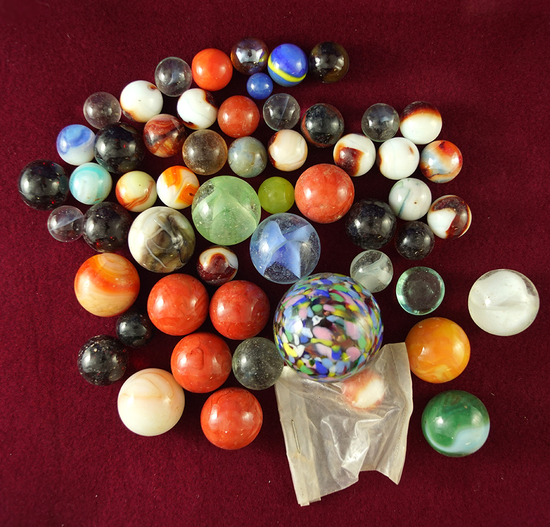 Large group of assorted old marbles which came in with a collection.