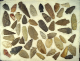 Very large group of assorted arrowheads and knives, largest is 3 3/8