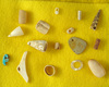 Nice selections of assorted bone and stone beads and pendants found on Anasazi sites in Arizona.