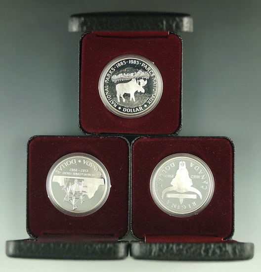 1982, 1985 and 1987 Canadian 50% Silver Commemorative Dollars in Original Holders