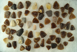 Large group of thumb scrapers, most are knife River Flint found in the Dakotas. Largest is 1 1/8