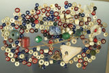 Group/bag of assorted small trade beads found in various locations.