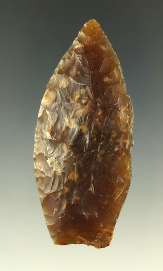 """2 7/16"""" Agate Basin with heavily ground lower edges made from semi translucent Knife River."""