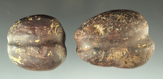 "Pair of fully grooved weights made from hematite found in Ohio, largest is 2 1/16""."
