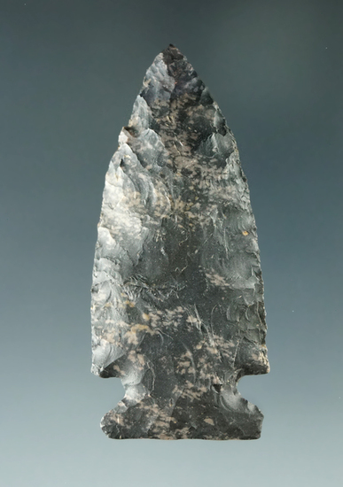 """2 3/8"""" well flaked Sidenotch point made from Coshocton Flint with minor restoration to tip."""