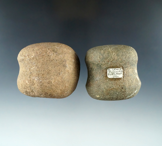 "Pair of Grooved Hammerstones, one found in Ohio and the other Indiana. Both around 1 3/4""."