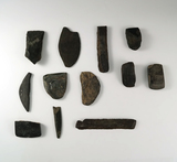 Group of assorted slate and stone tools and Ulus in various conditions found in British Columbia.
