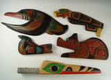 Five very ornate woodcarvings, one is a rattle, - yellow cedar by native artists in British Columbia