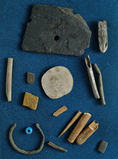 Group of assorted artifacts found near the Columbia River including bone, stone and trade beads. Lar