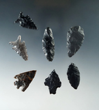 Set of seven assorted obsidian arrowheads, largest is 1 1/2