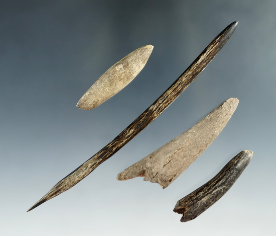 """Set of four bone and antler projectiles and tools found at a site in Kentucky. Largest is 5 1/8""""."""