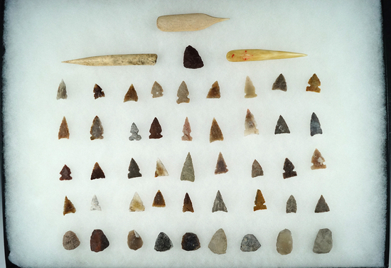 Large group of Projectile Points, 3 Bone Awls and Scrapers found in the High Plains Region.