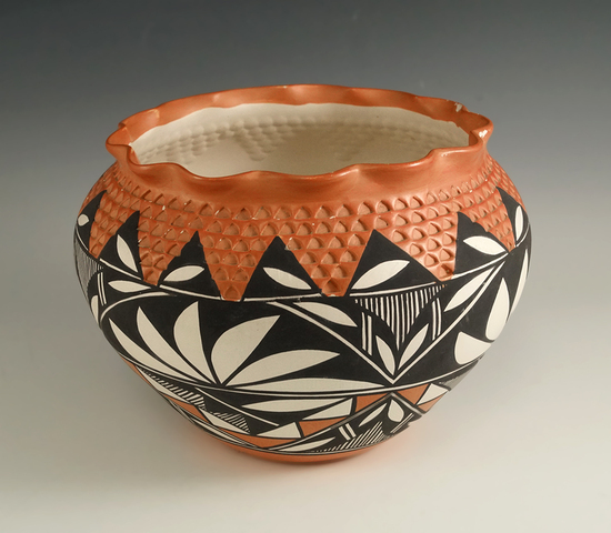 """5 1/4"""" Tall contemporary Southwest style pottery jar that makes a nice display item."""