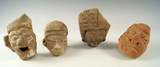 Set of four larger Pre-Columbian Mesoamerican pottery heads, one is broken and glued.