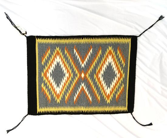 """18"""" by 24.5"""" genuine Navajo Indian rug made from 100% virgin wool."""