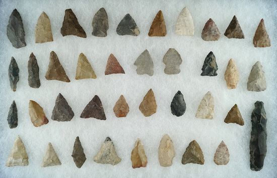 "Large group of approximately 38 assorted arrowheads from various locations. Largest is 2 7/8""."