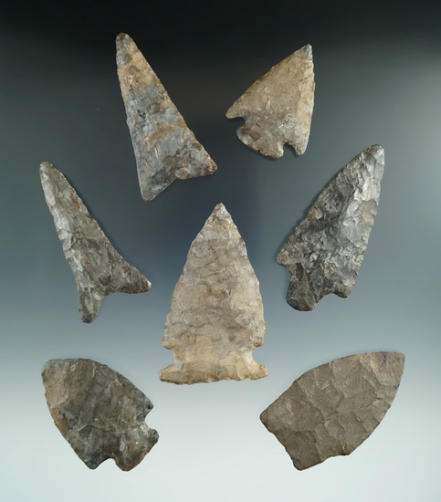 "Set of seven assorted New York arrowheads with minor restoration, largest is 2 5/8""."
