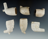Set of six ornate clay Pipes with broken stems.