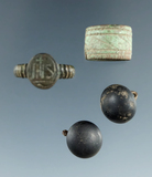 Group including a jesuit trade ring, copper ring and two brass buttons.