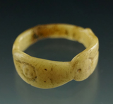 Beautifully crafted female figure motiff carved bone ring found in New York.