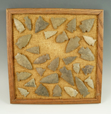 Group of approximately 30 assorted Pennsylvania arrowheads glued to a frame, largest is 2 1/8