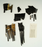 Group of artifacts that made up several large bone combs, all recovered from a site in New York.