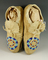 Pair of leather beaded double circle Moccasins in very nice conditon.