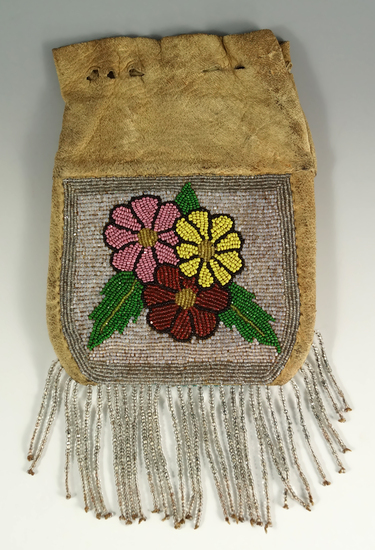 """6"""" tall leather Plateau Purse with nicely beaded drops. Circa 1900."""