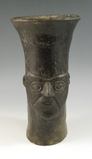 Pre-Columbian Inca Kero made from fired clay with a human face design. Stands 7 1/2
