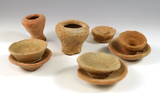 Set of nine miniature Old World Roman pottery artifacts. Largest is 1 7/8