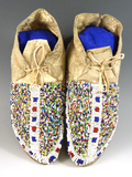 Excellent beadwork on this pair of deer skin child's Moccasins from the late 1800's/early 1900's.