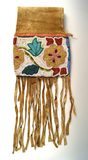 Nicely beaded Pipe Bag from the Great Lakes area with floral design. Circa late 1800's.