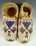 Pair of beautifully beaded Northern Plains Moccasins from the 1950's in very nice condition.