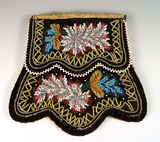 Exquisite Iriquois beaded flap Bag made from black velvet with beautiful beading.