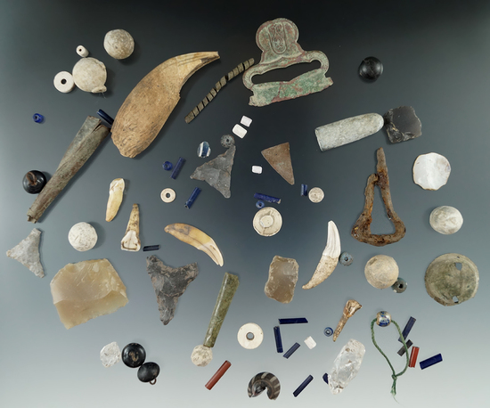 Surface recovered artifacts: bear tooth, Jews harp, Jesuit buttons and flints - various sites in NY.