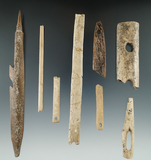 Group of assorted Alaskan bone artifacts recovered near the Bering Sea. Largest is a 6 1/8